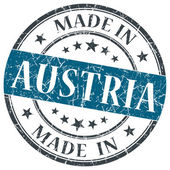 Made in Austria blue grunge round stamp isolated on white background — Stock Photo