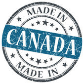 Made in Canada blue grunge round stamp isolated on white background — Stock Photo