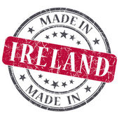 Made in Ireland red grunge round stamp isolated on white background — Stock Photo