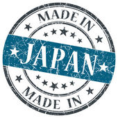 Made in Japan blue grunge round stamp isolated on white background — Stock Photo