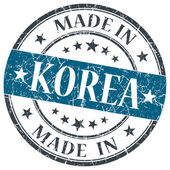 Made in Korea blue grunge round stamp isolated on white background — Stock Photo