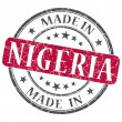 Made in NIGERIA red grunge stamp isolated on white background — Stock Photo