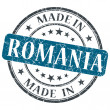 Made in Romania blue grunge round stamp isolated on white background — Stock Photo