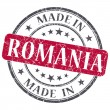 Made in Romania red grunge round stamp isolated on white background — Stock Photo