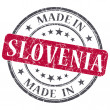 Made in Slovenia red grunge round stamp isolated on white background — Stock Photo #41495013