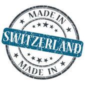 Fabricado en Suiza grunge azul redondo sello aislado sobre fondo blanco — Foto de Stock
