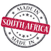 Made in SOUTH AFRICA red grunge stamp isolated on white background — Stock Photo