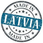 Made in LATVIA blue grunge stamp isolated on white background — Stock Photo