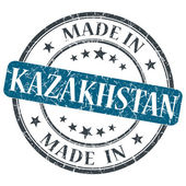 Made in KAZAKHSTAN blue grunge stamp isolated on white background — Stock Photo