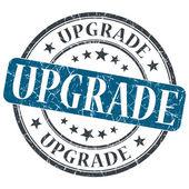 Upgrade blue grunge round stamp on white background — Stock Photo