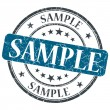 Sample blue grunge round stamp on white background — Stock Photo #42124213