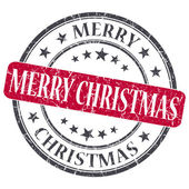 Merry Christmas red grunge round stamp on white background — Stock Photo