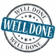 Well Done blue grunge round stamp on white background — Foto Stock