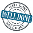 Well Done blue grunge round stamp on white background — Stock fotografie