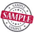 Sample red grunge round stamp on white background — Stock Photo #42329969