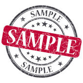 Sample red grunge round stamp on white background — Stock Photo