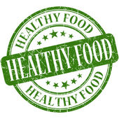 Healthy food green round grungy vintage rubber stamp — Stock Photo