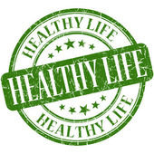 Healthy life green round grungy vintage rubber stamp — Foto de Stock