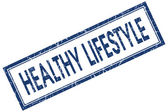 Healthy lifestyle blue square grungy stamp isolated on white background — Stock Photo