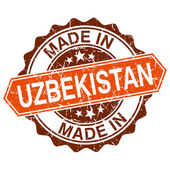 Made in Uzbekistan vintage stamp isolated on white background — ストックベクタ
