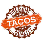 Tacos grungy stamp isolated on white background — Vettoriale Stock