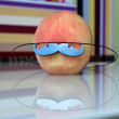 peach with mustache — Stock Photo