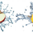 Pieces of fruit in the water — Stock Photo
