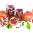 Stock Photo: Pomegranate and pomegranate juice on white background