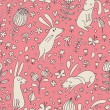 Rabbits on flower meadow. Cartoon seamless pattern with nice cute hares in vector. - Stock Vector
