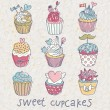 Sweet cupcakes vector set. Cartoon tasty cupcakes in pastel colors — Stock Vector #25066527