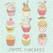 Stock Vector: Sweet cupcakes vector set. Cartoon tasty cupcakes in pastel colors