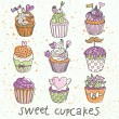 Sweet cupcakes vector set. Cartoon tasty cupcakes in pastel colors — Imagens vectoriais em stock