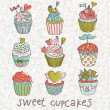 Sweet cupcakes vector set. Cartoon tasty cupcakes in pastel colors — Stock Vector #25066543