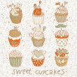 Royalty-Free Stock Vector Image: Sweet cupcakes vector set. Cartoon tasty cupcakes in pastel colors