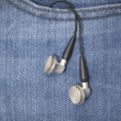 Earphones in pocket — Stock Photo