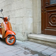 Stock Photo: Motorbike at door