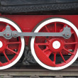 Stock Photo: Two locomotive wheels of red color