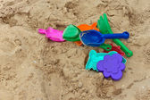 Varicolored toys on the sand — Foto Stock