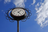 Clock in the shape of a flower — Stock Photo