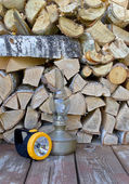Lamps are on a background of firewood — Stock Photo