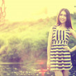 Fashion of a autumn girl wearing a striped Thailand. — Stock Photo