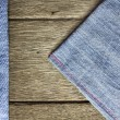 Wood background on blue jeans texture — Stock Photo #31574551