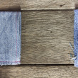 Wood background on blue jeans texture — Stock Photo