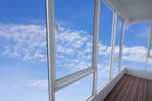 Window against a white wall and the cloudy sky — Stock Photo