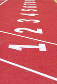 Start track. line on a red running track — Stok fotoğraf