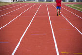 Man ready to start running on running track — Foto Stock