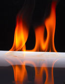 Fire flames on a background — Stock Photo