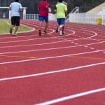 Man ready to start running on running track — Stock Photo #39402543