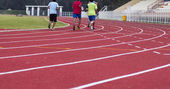 Man ready to start running on running track — Stok fotoğraf