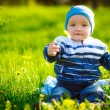 Happy kid lie on green grass — Stock Photo